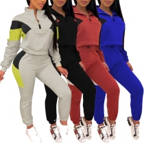 Modern Sportpak met Contrasterende Kleuren bestaand uit een Sweatshirt met Opstaande Kraag + Broek