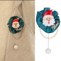 Leuke Broche met Kunstparelhanger en Kerstmanvorm