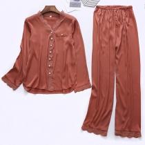 Moderne Pyjama in Effen Kleur bestaande uit een Topje met Lange Mouwen en V-hals + Broek
